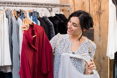 Woman buying dresses Stock Images