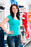 Woman buying fashion blue jeans Stock Photo