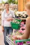 Woman buying flower shopping basket garden center Stock Images