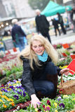 Woman buying flowers on the market Royalty Free Stock Photography