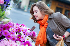 Woman buying flowers at market Stock Image