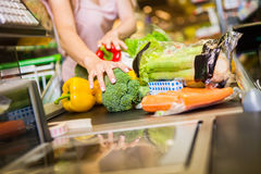 Woman buying food at the grocery store Stock Image