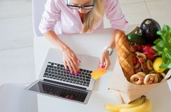 Woman buying food online. Housewife buying food online, shopping online concept stock image