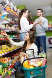 Woman buying food in a shop Royalty Free Stock Photo