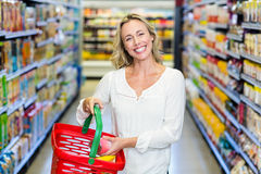 Woman buying food and smiling at the camera Stock Image