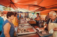 Free Woman Buying Fresh Fish On Street Market Of The Popular Fishing Town Stock Photo - 163968580