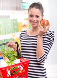 Woman buying fresh fruit at supermarket Stock Image