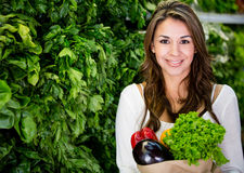 Woman buying fresh vegetables Stock Image