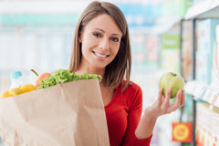 Woman buying fresh vegetables Stock Images