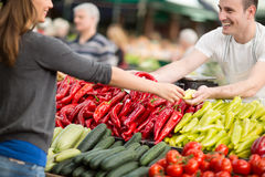 Woman buying fresh vegetables at street market Stock Images