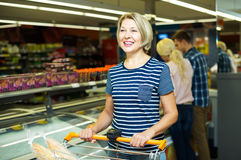 Woman buying frozen vegetables Stock Photography