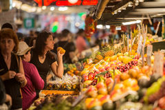 Woman Buying Fruit at Pike Street Market Stock Images