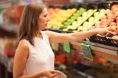 Woman buying in a fruit shop royalty free stock photos