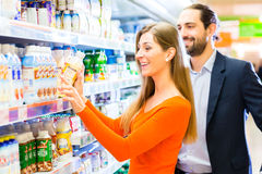 Woman buying fruits in grocery store Stock Images