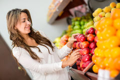 Woman buying fruits at the supermarket Royalty Free Stock Photos