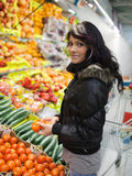 Woman buying fruits and vegetables Stock Photography