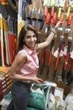 Woman Buying Gardening Tools Royalty Free Stock Image