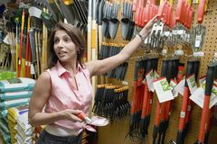 Woman Buying Gardening Tools Royalty Free Stock Images