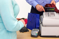Woman buying gifts for a man Stock Photo