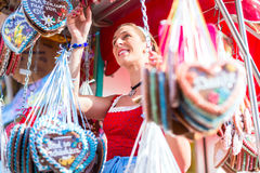 Woman buying gingerbread heart at Oktoberfest Royalty Free Stock Photos