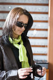 Woman buying glasses Stock Images