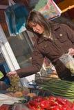 Woman buying grapes Stock Photos