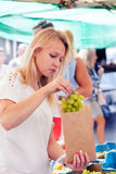 Woman buying grapes Royalty Free Stock Photography