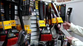Woman buying grill spatula and nylon brush for bbq machine a. T Sears store stock video footage