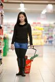 Woman Buying Groceries Stock Images