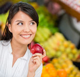 Woman buying groceries Stock Image