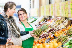 Woman buying groceries at farmers market stand Stock Photos