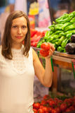 Woman buying in a grocery store royalty free stock images
