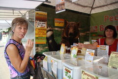 Woman buying honey at the market Royalty Free Stock Images
