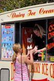 Woman buying ice cream from a van. Stock Images