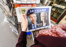 Woman buying international press with Emmanuel Macron and Marine Royalty Free Stock Photography