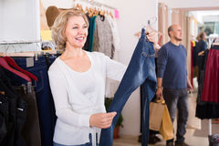 Woman buying jeans Stock Images