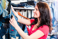 Woman buying jeans in shop Royalty Free Stock Photography