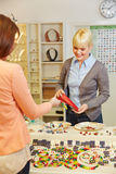 Woman buying jewelry in store Royalty Free Stock Photos
