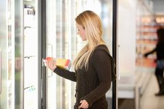 Woman Buying Juice from Cooler Stock Photo