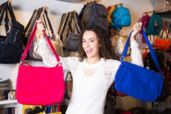 Woman buying leather purse in haberdashery shop Royalty Free Stock Images