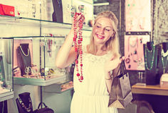 Woman buying long necklace Stock Photography