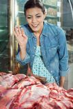 Woman Buying Meat In Butchery Royalty Free Stock Photos
