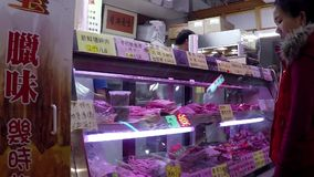 Woman buying meat stock video