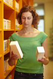 Woman buying medicine Royalty Free Stock Image