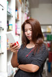 Woman buying medicine Stock Image