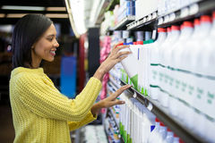 Woman buying milk from dairy section Stock Image