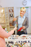 Woman buying necklace in a jewelry Royalty Free Stock Photos
