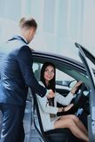 Woman buying a new car. Woman buying a new car Royalty Free Stock Photography