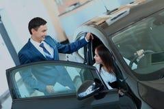 Woman buying a new car. Woman buying a new car Stock Photos