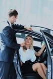 Woman buying a new car. Woman buying a new car Royalty Free Stock Photo